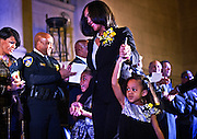 Marilyn Mosby leads her children, Nylyn, 6 (left,) and a reluctant Aniyah, 4, onto the grandstand past Mayor Stephanie Rawlings-Blake and Baltimore Police Commissioner Anthony Batts during her Inauguration as State's Attorney for Baltimore at the War Memorial in Baltimore. A few months later she would appear on the national stage as the unrest follwing the death of Freddie Gray roiled Baltimore. Mosby's office prosecuted six police officers involved in the fatal injury of Gray while in police custody. Batts was later relieved of his duties over the Gray case and Rawlings-Blake has announced she will not run for mayor again.