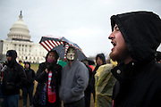 Ben Zucker, 22, of Silver Spring, MD, addresses the protestors on the west front lawn of the Capitol on Tuesday. Hundreds of protestors with the Occupy movements gathered outside the Capitol, waving signs and chanting against a barrier of police.