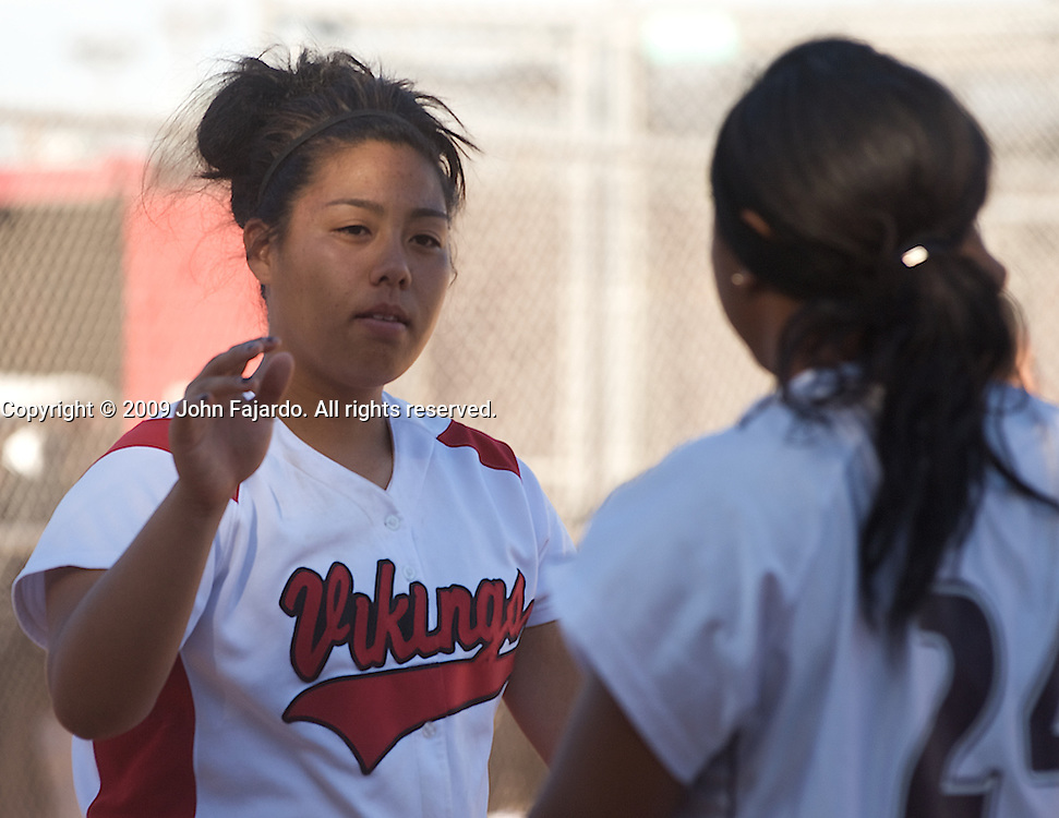 Monique Ogata(l) high fives a player from Mt. SAC at the LAC softball field on Tuesday April 21, 2009.  The Vikings lose the final regular season home game 5-1.