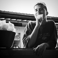 Young orphan Street vendor in Yoro, Honduras selling snack to survive