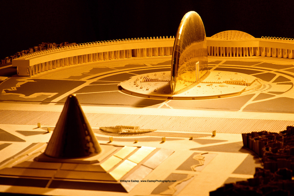 "This Architectural model is one of the prposals for the new government center in Astana, which became Kazakhstan's capital in 1998.  The building concept was designed and developed by architect Bek Ibrayev and his staff.  Its composition is bas on principles of organized space use in ancient turkic and hunnish headquarters.  The ""Senior Yurt,"" where decisions that affect the whole country are made, is kplaced in the center.  As in ancient times, the main axes of the proposed building are strictly oriented on a north-south, east-west basis to secure the patronage of the higher powers and bring well-being and good fortune to the country and its leadrs."