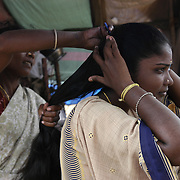 A woman has her hair braided in a temporary relief camp set up by the Indian government for the 312 families of the nearby village of Karikattukuppam in Tamil Nadu, India on January 14, 2005 after the area was struck by the Indian Ocean Tsunami on December 26, 2004. Generated by an earthquake on the ocean floor, the tsunami devastated the fishing industry along the southeastern coast of India. .