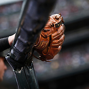 SHOT 5/28/11 5:12:08 PM - The Colorado Rockies Troy Tulowitzki and his glove get ready to take the field against the St. Louis Cardinals during their regular season MLB game at Coors Field in Denver, Co. The Rockies won the game 15-4. Tulowitzki has won a Gold Glove in 2010 for his play at shortstop.The award given annually to the Major League Baseball players judged to have exhibited superior individual fielding performances. (Photo by Marc Piscotty / © 2011)