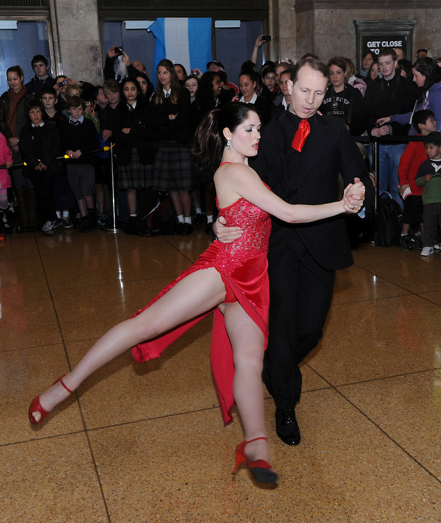 New Zealand Tango champions John and Felicity Flowers demonstrate to the All Blacks at a promotion for the International test against Argentina on Saturday night, at the Railway Station, Wellington, New Zealand, Monday, September 03, 2012. Credit:SNPA / Ross Setford