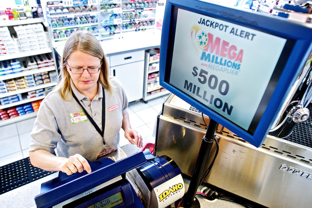 Darla Helmerick prints out $10 worth of Mega Millions tickets Thursday at Ady's Convenience and Car Wash in Post Falls. With a jackpot of more than half of a billion dollars, the store sold nearly $1,000 in Mega Millions tickets before noon.