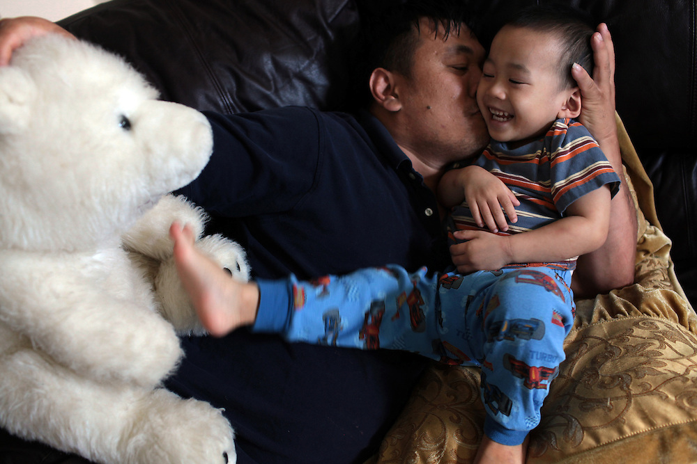 After shrimp season was closed because of the BP oil spill in the Gulf of Mexico, shrimp boat captain Minh Vo plays with his son Quentin Vo, 2, at their home in Marrero, LA on May 23, 2010.  By the time the $5,000 check from BP arrived, it was spent within days paying bills. Now the family of six don't know how to survive. Forced from his shrimp boat, Minh Vo began cooking, cleaning and looking after the children at home while his wife found a job in a nail salon two weeks earlier.