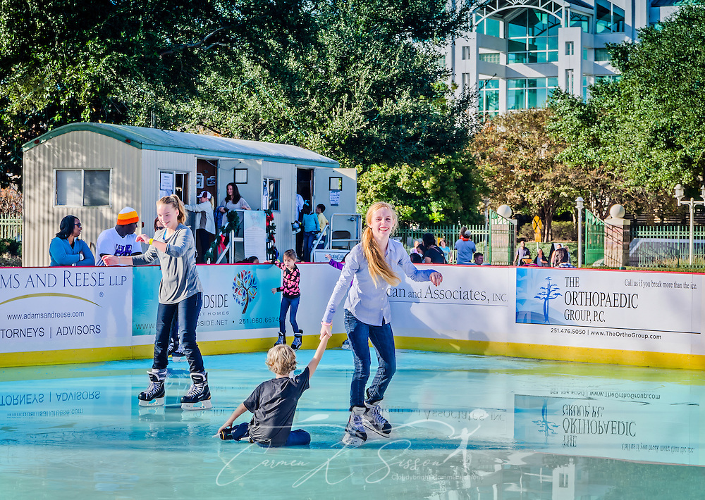 Children ice skate at Riverside Ice in Cooper Riverside Park, November 27, 2015, in Mobile, Alabama. In the background are the Renaissance Mobile Riverview Plaza and the Battle House Renaissance Mobile Hotel and Spa. (Photo by Carmen K. Sisson/Cloudybright)