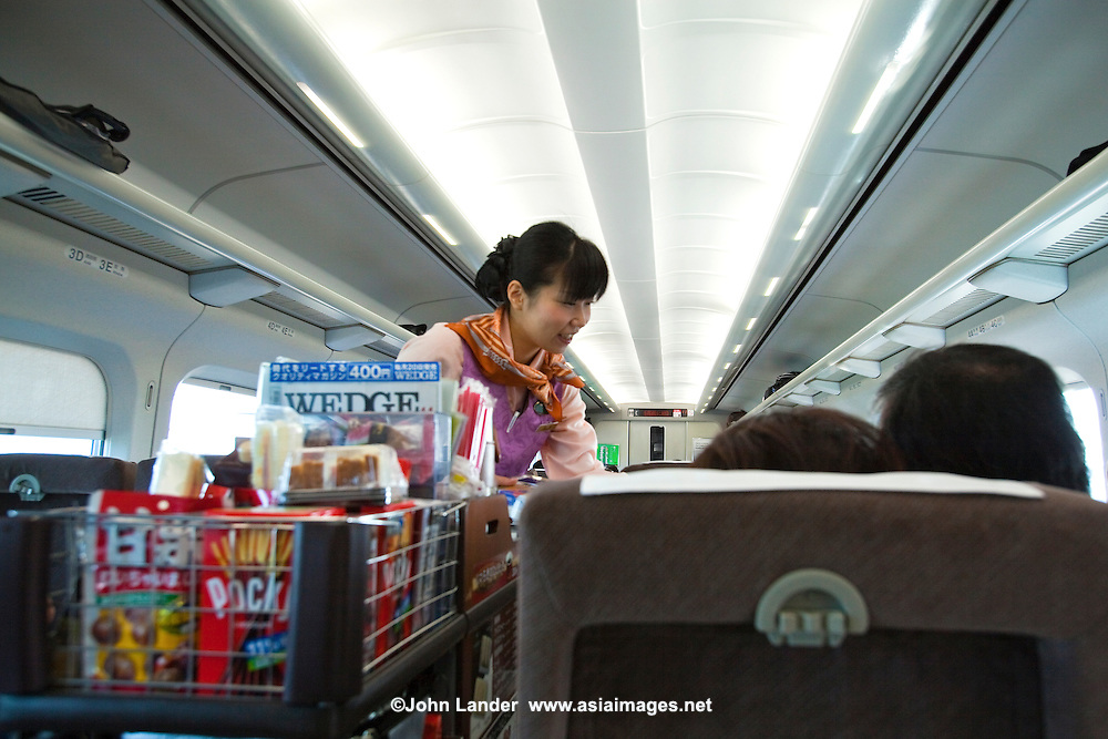 Shinkansen Snack Trolley Service -The Shinkansen is a network of high-speed railway lines in Japan operated by JR or Japan Railways.  Starting with the 210km/h Shinkansen in 1964 the  2,500 km long network has expanded to link most major cities on the islands of Honshu and Kyushu at speeds up to 300km/h.