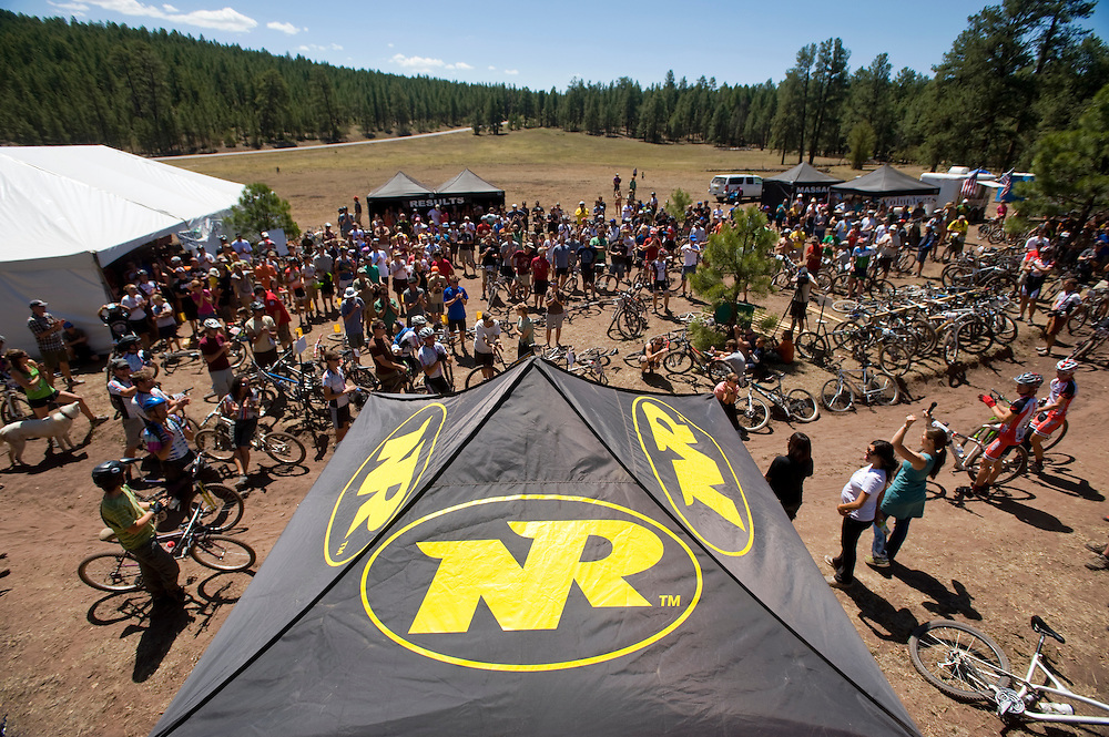 Mountain bikers gather for the pre-race meeting during the 24 Hours in the Enchanted Forest mountain bike race near McGaffey Saturday. The event drew 340 registered racers plus their family, friends and support crew.