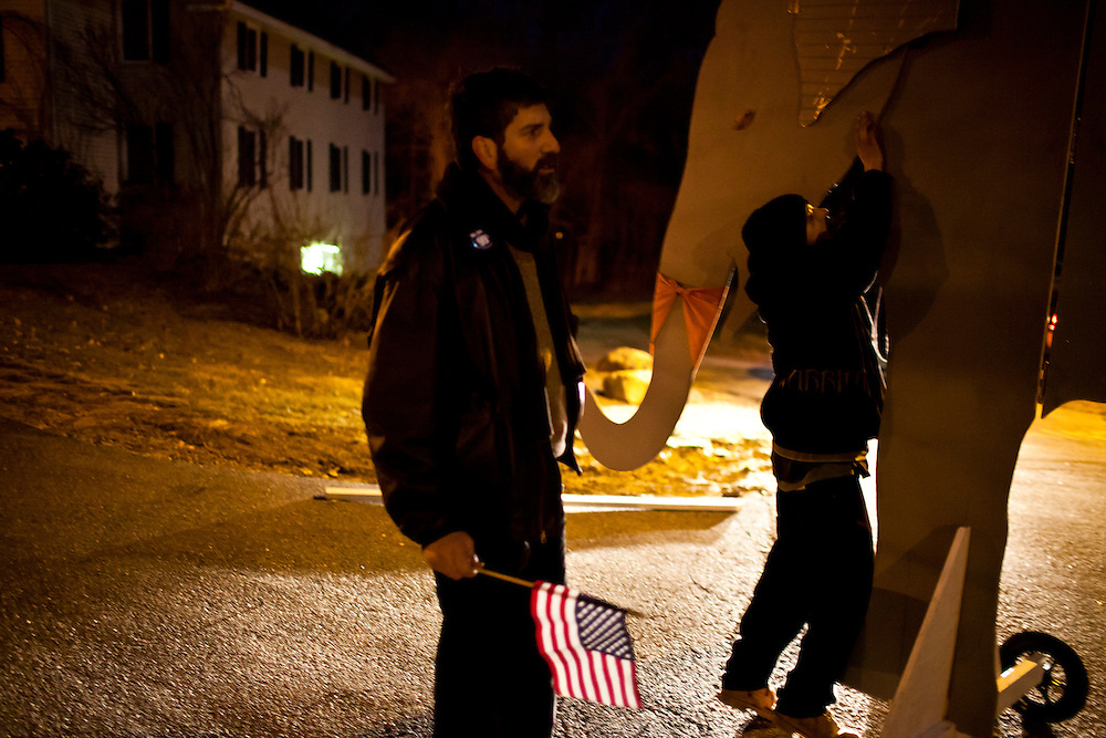 Occupy Boston protesters disassemble a large wooden elephant after demonstrating outside the site of the WMUR/ABC News Debate at Saint Anselm College on Saturday, January 7, 2012 in Manchester, NH. Brendan Hoffman for the New York Times