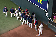 Members of the Minnesota Twins bullpen give Samuel Deduno #21 and Chris Herrmann #12 high fives before a game against the Milwaukee Brewers on May 29, 2013 at Target Field in Minneapolis, Minnesota.  The Twins defeated the Brewers 4 to 1.  Photo: Ben Krause