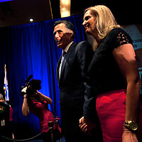 ORLANDO, FL -- September 22, 2011 -- Republican presidential candidate Gov. Mitt ROmney and his wife, Ann, wait to take the stage during the Florida P5 Faith and Freedom Coalition Kick-Off at the Rosen Centre Hotel in Orlando, Fla., on Thursday, September 22, 2011.  Nine Republican presidential candidates congregated for a Fox News / Google Debate.   (Chip Litherland for The New York Times)