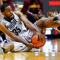 WEST LAFAYETTE, IN - MARCH 09: Rapheal Davis #35 of the Purdue Boilermakers and Rodney Williams #33 of the Minnesota Golden Gophers battle for a loose ball at Mackey Arena on March 9, 2013 in West Lafayette, Indiana.  (Photo by Michael Hickey/Getty Images) *** Local Caption *** Rapheal Davis; Rodney Williams