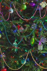 detail of a Christmas tree with ornaments and lights