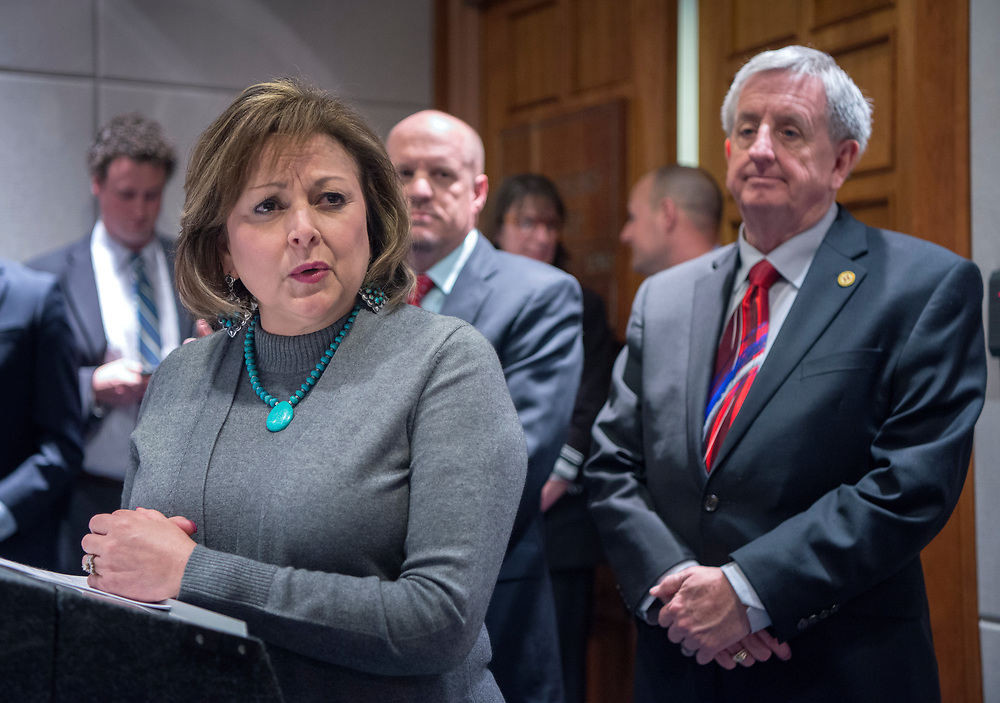em031817c/a/Gov. Susana Martinez, left, surrounded by House Republicans, including Rep. Tim Lewis, R-Rio Rancho, center, and Rep. James Smith, R-Sandia Park, announced she will be calling a special session to do more work on the budget. This was at the Roundhouse in Santa Fe, Saturday March 18, 2017. (Eddie Moore/Albuquerque Journal