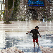 Children playing in the dancing water at Kemah Boardwalk. Kemah Boardwalk is an entertainment complex in Kemah, Texas, featuring an amusement park, hotel, dining, and music.