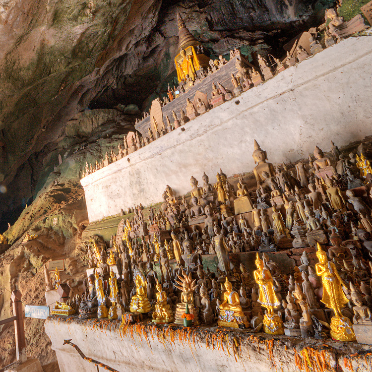 Hundreds of Buddhas lined up in Pak Ou Caves, Luang Prabang, Laos
