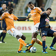 Union Midfielder Michael Farfan #21 (right) tries retains procession of the ball as Dynamo Attacker Carlo Costly #29 (middle) and Dynamo Midfielder Je-Vaughn Watson #10 (left) go for the ball during Saturday MLS regular season match between The Philadelphia Union and The Houston Dynamo. The Dynamo and The Philadelphia Union played to a 1-1 tie. Saturday Aug. 6, 2011. at PPL Park in Chester PA...The News Journal/SAQUAN STIMPSON