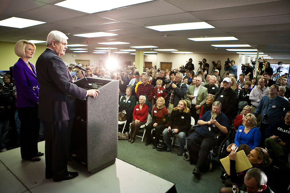 Republican presidential candidate Newt Gingrich, joined by his wife Callista Gingrich, left, speaks at the opening of a new campaign office on Saturday, December 10, 2011 in Urbandale, IA.
