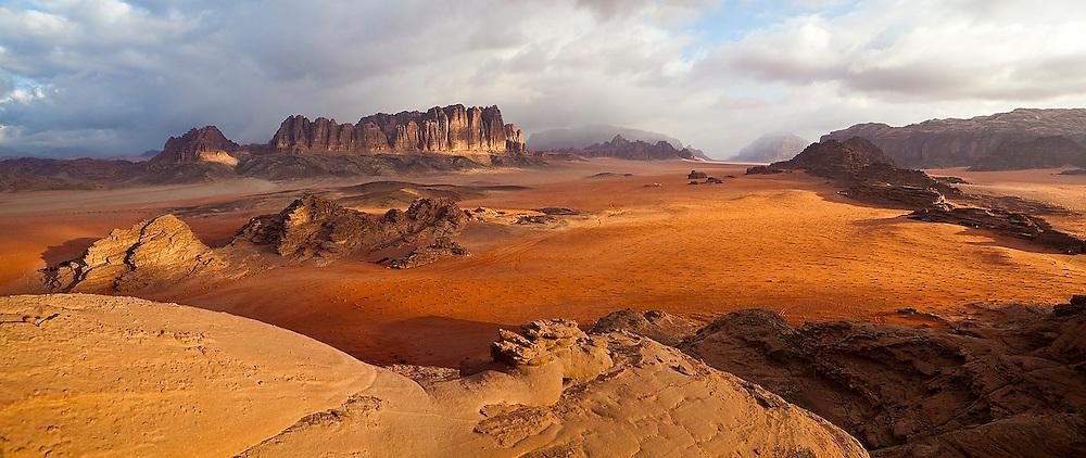 Red sand desert and sandstone cliffs in Wadi Rum, Jordan.