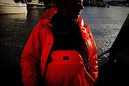 Vestfjorden, Nordland, Norway, 24.03.12..Skipper Steinar in Svolvær harbour...The vessel Anne Marie with skipper Steinar Henriksen and (blue cap) brought out Team Olsen at the Arctic Cod fishing world championship. The team; Geir L. Olsen (glasses), Magne Øvregård (white hat/red rainclothes) and Peder E. Vik (dark hair) won the following awards in the world championship:.1st place four man team with 2351,40kg Geir, Peder and Magne (last person sick, so the three competed with handicap)..1st place two man team Geir with Torunn Handeland.2nd place total weight - Geir L. Olsen.4th place total weight - Peder E. Vik.6th place total weight - Magne Øvregård.Steinar Henriksen was also awarded best skipper...Photo by: Eivind H. Natvig/MOMENT