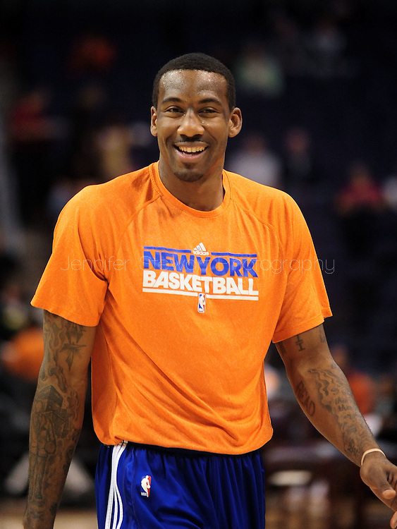 Jan. 7 2011; Phoenix, AZ, USA; New York Knicks forward Amar'e Stoudemire (1) reacts on the court prior to a game against the Phoenix Suns at the US Airways Center. The Knicks defeated the Suns 121-96. Mandatory Credit: Jennifer Stewart-US PRESSWIRE.