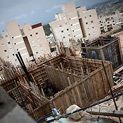 Palestinian worker's seen working on Israeli settlements. Some would see this to be quite ironic, a Palestinian building Israeli settlements on Palestinian land. These settlements are seen as illegal by international law although Israel disputes this. Image © Angelos Giotopoulos/Falcon Photo Agency