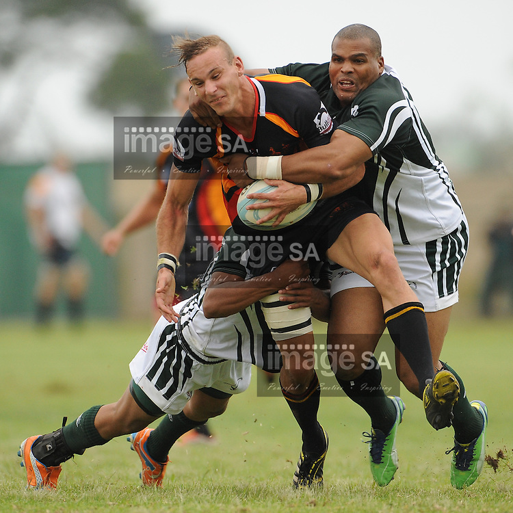 GEORGE, SOUTH AFRICA - Saturday 7 March 2015, Wesley Flanagan of Vaseline Wanderers is tackled by isaac Treurnicht of Pacaltsdorp Evergreens during the third round match of the Cell C Community Cup between Pacaltsdorp Evergreens and Vaseline Wanderers at Pacaltsdorp Sports Grounds, George<br /> Photo by Roger Sedres/ImageSA/ SARU