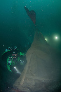 GUE Diver uses liftbag to bring ghostnet to surface