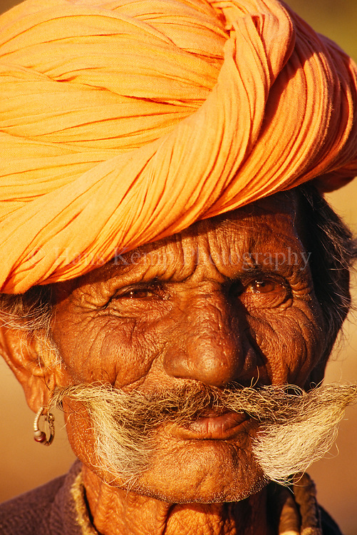 A man sporting a well groomed mustache and wearing the traditional turban of Rajasthan, India, 1995