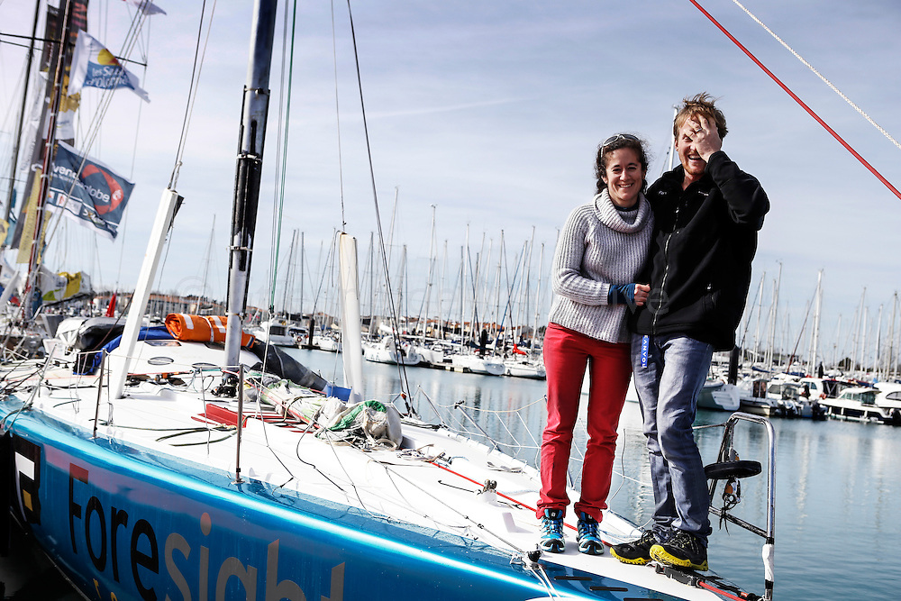 New Zealand sailor Conrad Colman on his boat the day after he crossed the Vendee Globe Race finish line in Sables d'Olonne. With his wife Clara on Foresight  deck. 25 February 2017.