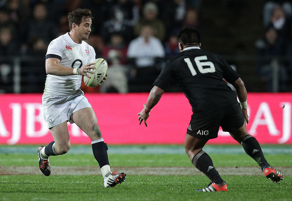 England's Danny Cipriani is challenged by New Zealand's Keven Mealamu in an International Rugby Test match, Waikato Stadium, Hamilton, New Zealand, Saturday, June 21, 2014.  Credit:SNPA / David Rowland
