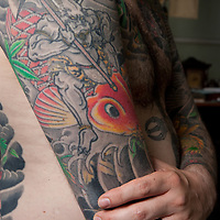 Alex Reinke (also known as Horikitsune)-the German understudy of expert Japanese tattoo artist Horiyoshi III, shows his full body suit of tattoos done by his master, in Horiyoshi's studio in Yokohama, Japan, on Saturday 10th September 2011. Tattoo shows a red Koi carp with an Oni demon (Buddhist supporter) with axe.