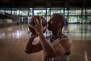 2016/04/19 &ndash; Medellín, Colombia: Oscar Rios, 42, prepares to throws the ball to the basket during the training warm-up session of Antioquia&rsquo;s team at Atanasio Girardot Stadium, Medellin, 19th March, 2016.  <br /> -<br /> After his military service Oscar started to work as a bodyguard for a public prosecutor, a time of great violence in Medellin, during the 1990&rsquo;s when Pablo Escobar ran the city. <br /> On an assassination attempt of the public prosecutor, Oscar was shot seven times by Escobar&rsquo;s assassins. As a result he lost the mobility of his legs and feet, becoming paraplegic. <br /> The adaptation to a new life was hard, but he decided that he had to separate the injury under his waist from his head, and to keep doing what he wanted. Oscar had always liked basketball, so he decided to dedicate himself to it. In 1998 he became part of Team Colombia on wheelchair basketball. During his successful career he was several time South American Champion, was with Colombia on the top ten teams at the 2014 World Championship in Korea and went to the 2012 Paralympic Games in London. Unfortunately, this year Colombia missed the qualification for the Rio 2016 Paralympic, which was Oscar last opportunity to be back at an Olympics. <br /> He plans to retire soon and became a full-time basketball coach. Oscar believes that there is much talent in Colombia that needs to be fostered. When asked about the accident and his life on the wheelchair, Oscar says, &ldquo;Before I was an arrogant person and didn&rsquo;t have any love to give to my family. The accident was a blessing that made me a better, happier man and to appreciate more my life and family. If I was going to be born tomorrow, I wanted to be born on a wheelchair&rdquo;. (Eduardo Leal)