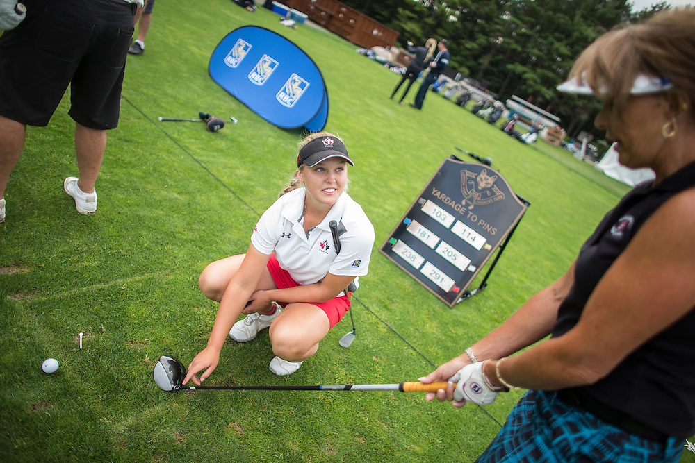 London, Ontario ---2014-08-19--- Rising Canadian golf star Brooke Henderson, gives tips to Paula Stoyanovich of London during a golf clinic on the second day of the Canadian Pacific Women's Open at the London Hunt and Country Club, August 19, 2014  <br /> GEOFF ROBINS The Globe and Mail