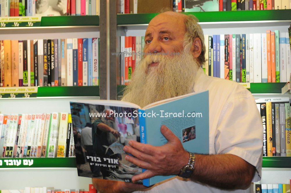 Uri Yarmias (AKA Uri Buri) an Israeli chef promotes his latest cookbook in a book store