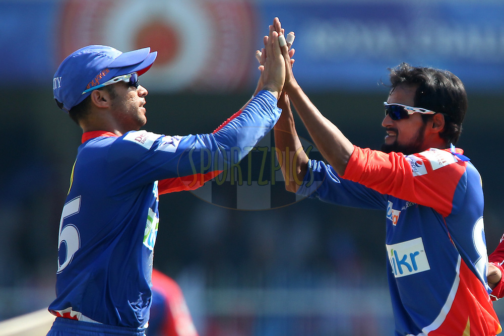 Shahbaz Nadeem of the Delhi Daredevils celebrates the wicket of Ambati Rayudu of the Mumbai Indians during match 16 of the Pepsi Indian Premier League 2014 between the Delhi Daredevils and the Mumbai Indians held at the Sharjah Cricket Stadium, Sharjah, United Arab Emirates on the 27th April 2014<br /> <br /> Photo by Ron Gaunt / IPL / SPORTZPICS