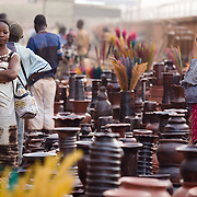 A woman selling pottery greets customers at the 22nd Salon International de l'Artisanat de Ouagadougou (SIAO) in Ouagadougou, Burkina Faso on Saturday November 1, 2008.