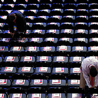 Programs are arranged on the delegates seats at the Republican National Convention at the Tampa Bay Times Forum