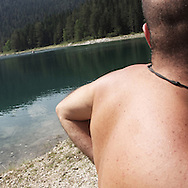 a man near a Dorumitor lake. There are several arguments about the derivation of the name  &quot;Montenegro&quot;, one of these relates to dark and deep forests  that once covered the Dinaric Alps, as it was possible to see them from the sea. <br />