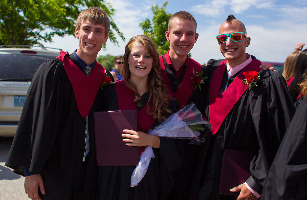 Ridgetown, Ontario ---2014-06-06--- From left, Matt Hebblethwaite, Christianne Dunnink, John Renkema, Jonathon Godwaldt, pose for a photo following Ridgetown College's graduation ceremony in Ridgetown, Ontario June 6, 2014.<br /> GEOFF ROBINS Farmers Forum