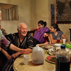 Grandparents Maha Sarsour, 51, and Nidal Sarsour, 63, daughter Linda Sarsour, 31, granddaughters Sabreen Judeh,10, and Sajida Judeh, 7, have dinner with other members of their Palestinian-American family at their home in Brooklyn, N.Y., Sept. 15, 2011.