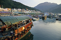 A junk ferry in Sok Kwu Wan Bay, Lamma Island, Hong Kong, China..