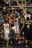 Ohio State forward Jared Sullinger (0) makes a rebound while being contested by Michigan forward Jordan Morgan (52) in the first half of the Big Ten Tournament semifinals in Indianapolis, on March, 11, 2011, at Conseco Fieldhouse. Ohio State defeated Michigan 68-61.
