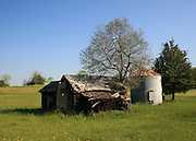 Abandoned tobacco barn and silo in the Georgia countryside in the Spring.