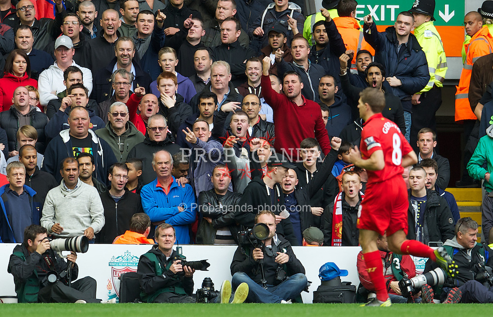 LIVERPOOL, ENGLAND - Sunday, September 23, 2012: Still fuelled by hate? Manchester United supporters hurl abuse at Liverpool and England captain Steven Gerrard during the Premiership match at Anfield. (Pic by David Rawcliffe/Propaganda)