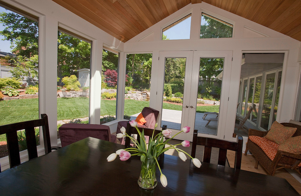 Stratford, Ontario ---10-05-20--- The home of the Stratford Festival's Artistic Director Des McAnuff and his partner Bryna McCann has a sun porch with a large dining table.<br /> GEOFF ROBINS The Globe and Mail