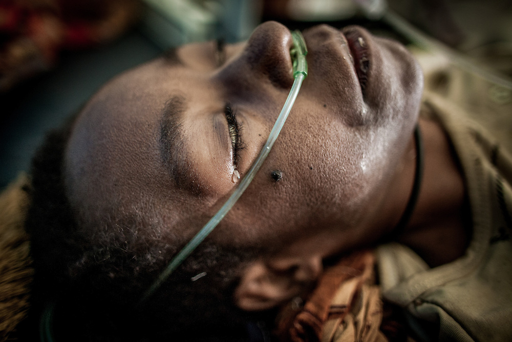 Unconscious, a tear rolls off Mandisa's face as she lay on the hospital bed at the brink of death. <br /> <br /> Mandisa (25) who is in the late stage of AIDS clings to her life.  After being sick for many months, Mandisa's family finally brought her to the hospital to get medical treatment.  Due to a lack of experienced health staff, family and friends must stay by her side the entire time.  Her condition suddenly deteriorated overnight and her body went into a state of shock and she lost consciousness.<br /> <br /> In Papua, all indigenous Papuans have access to health insurance, called Jamkesmas or Jaminan Kesehatan Masyarakat Miskin, provided at no cost by the provincial government. However, inadequate facilities, limited availability of medical equipment and medicines, and inexperienced health staff have made it difficult for indigenous Papuans to get tested for HIV/AIDS and receive quality assistance, counseling, and long-term care.  Many health staff in Papua still lacks medical training to run and manage Voluntary Counseling and Testing (VCT) clinics.  In other places, even when health personnel have sufficient training, their clinics are often overcrowded and inadequate, lacking proper equipment such as testing reagents, centrifuge, HIV rapid tests, CD4 machines, and medicines to treat opportunistic infection and antiretroviral therapies.  In some cases, health care workers fail to monitor and maintain the availability of necessary supplies and medicines to avoid shortages.