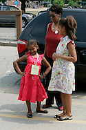 Sasha(L) and Malia(R) Obama, daughters of Democratic presidential hopeful Senator Barack Obama, wait for their mother Michelle Obama with their grandmother Marian Robinson(C) during a campaign stop in Concord, New Hampshire June, 2, 2007. .