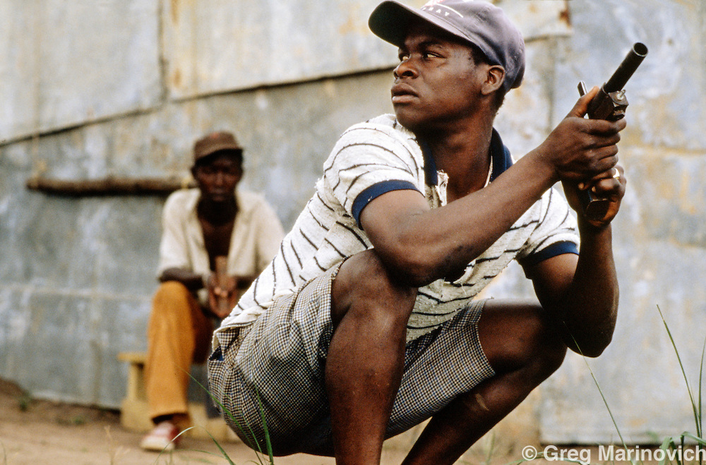 KwaMashu township, KwaZulu Natal, Durban, South Africa. ANC supporter with homemade 'kwash' in clashes between African National Congress and Inkatha Freedom Party supporters, 1994.